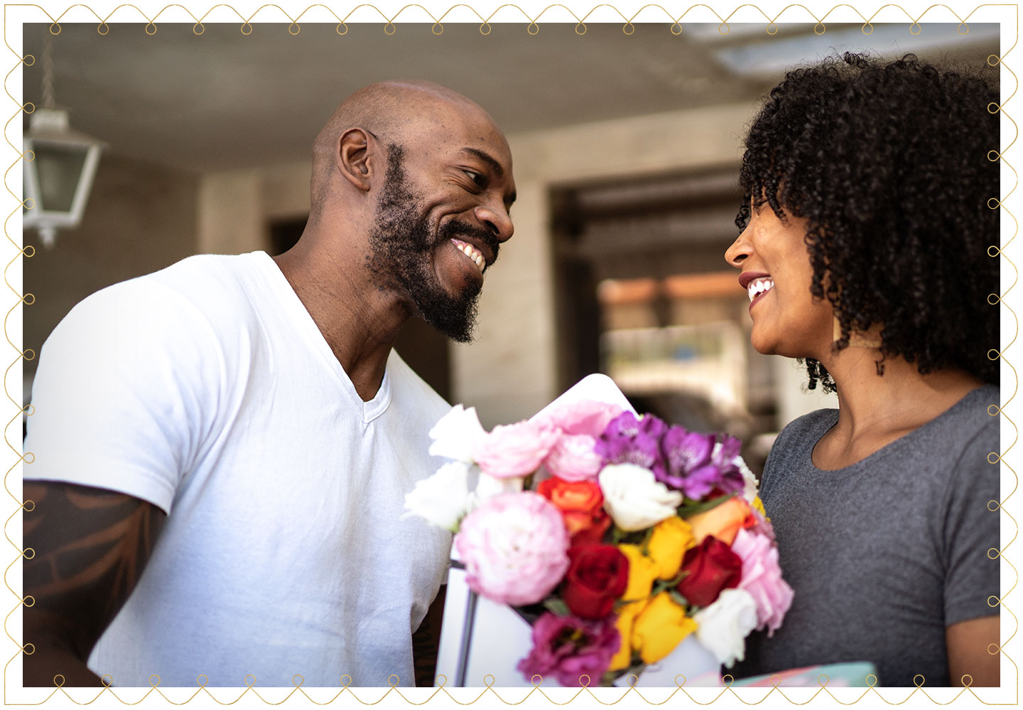 happy couple exchanging a colorful bouquet of flowers