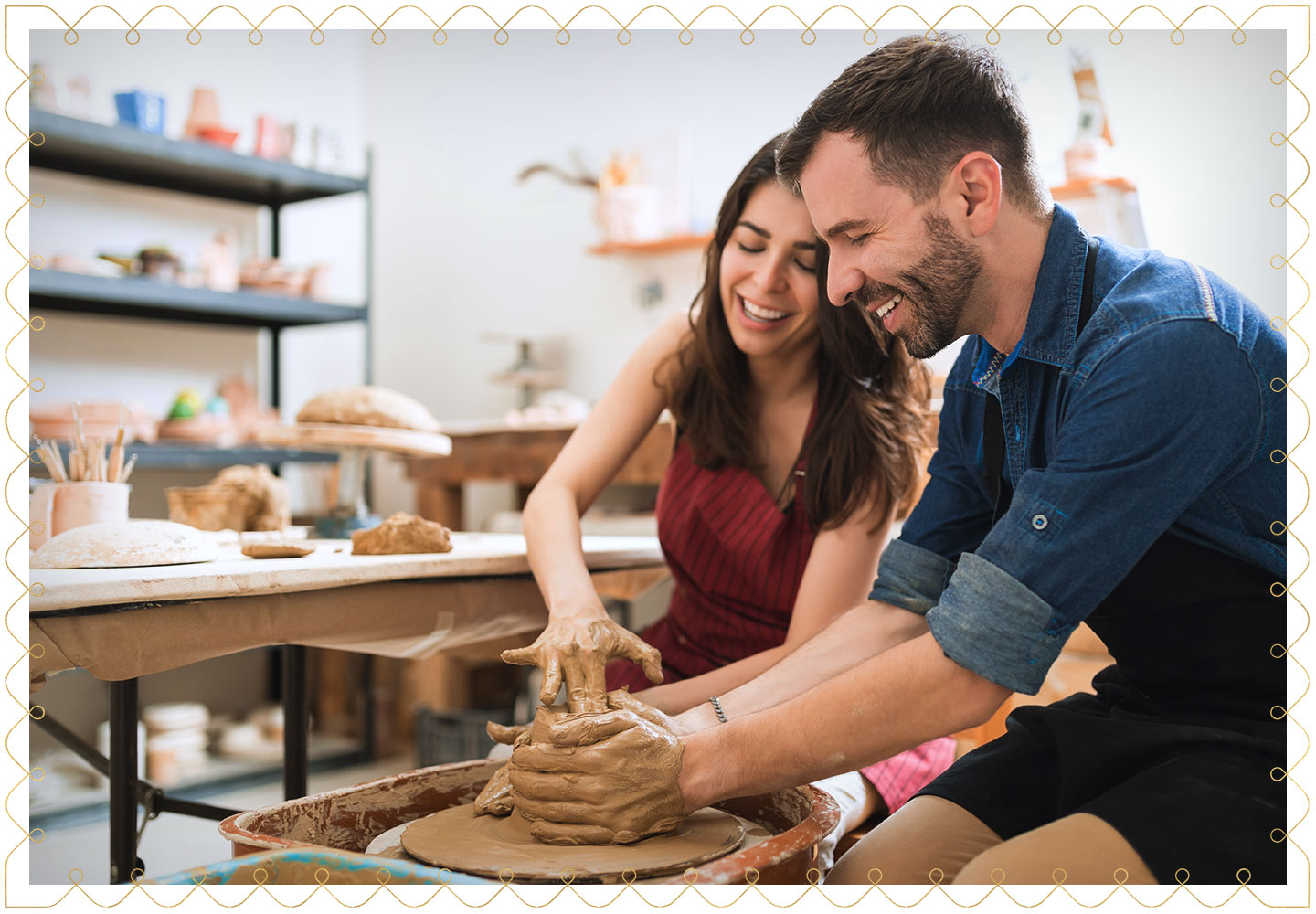 a couple trying out pottery together having fun