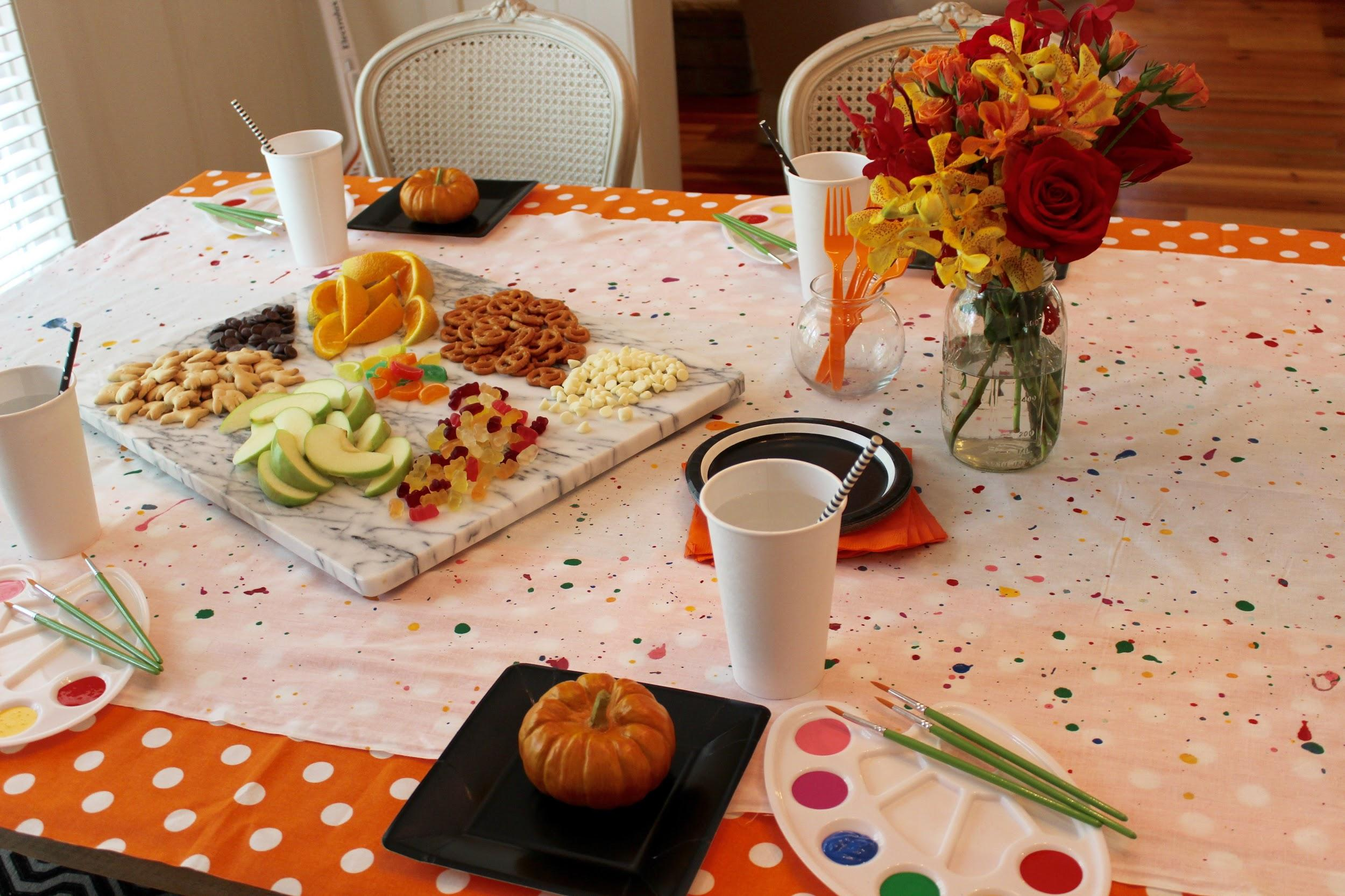 autumn party food and flowers on a table with paint 2