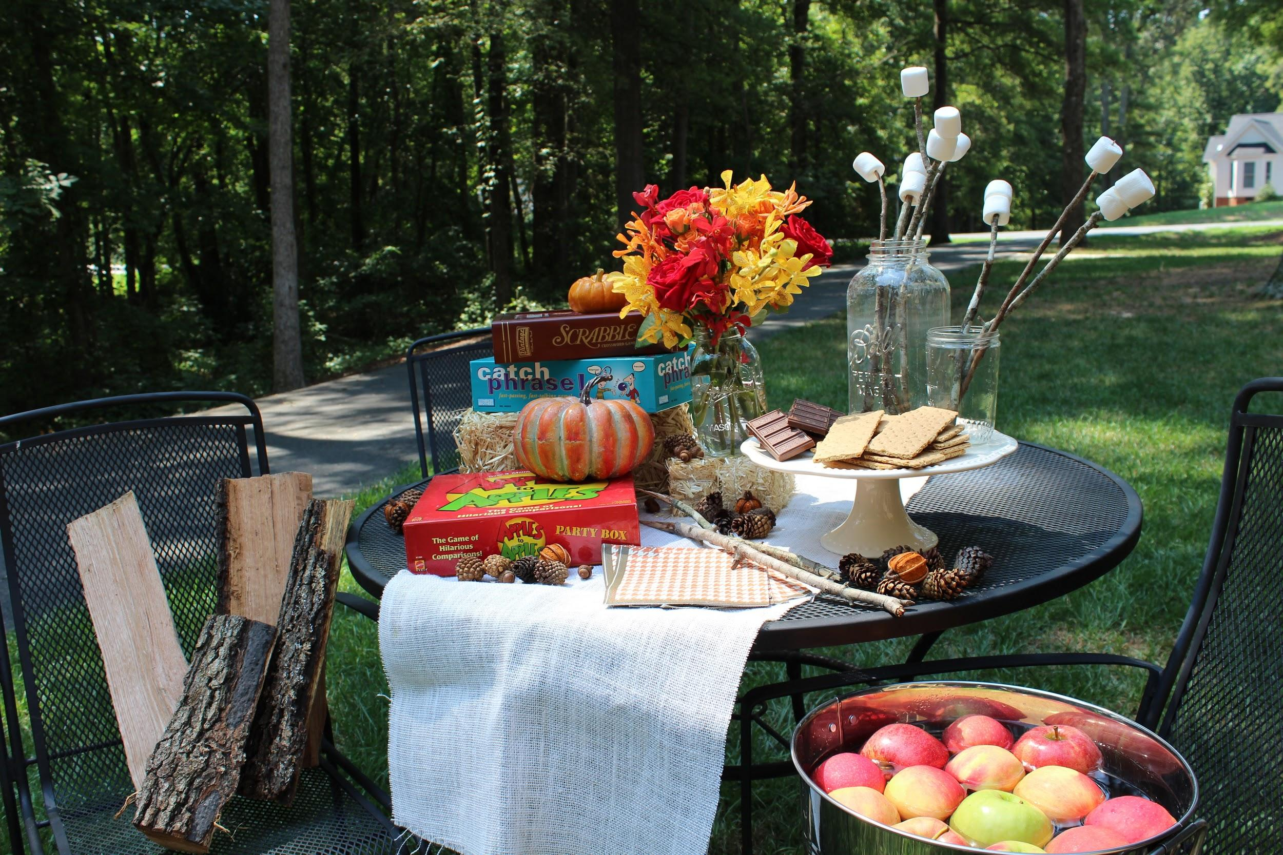 autumn party games and decorations on table outside