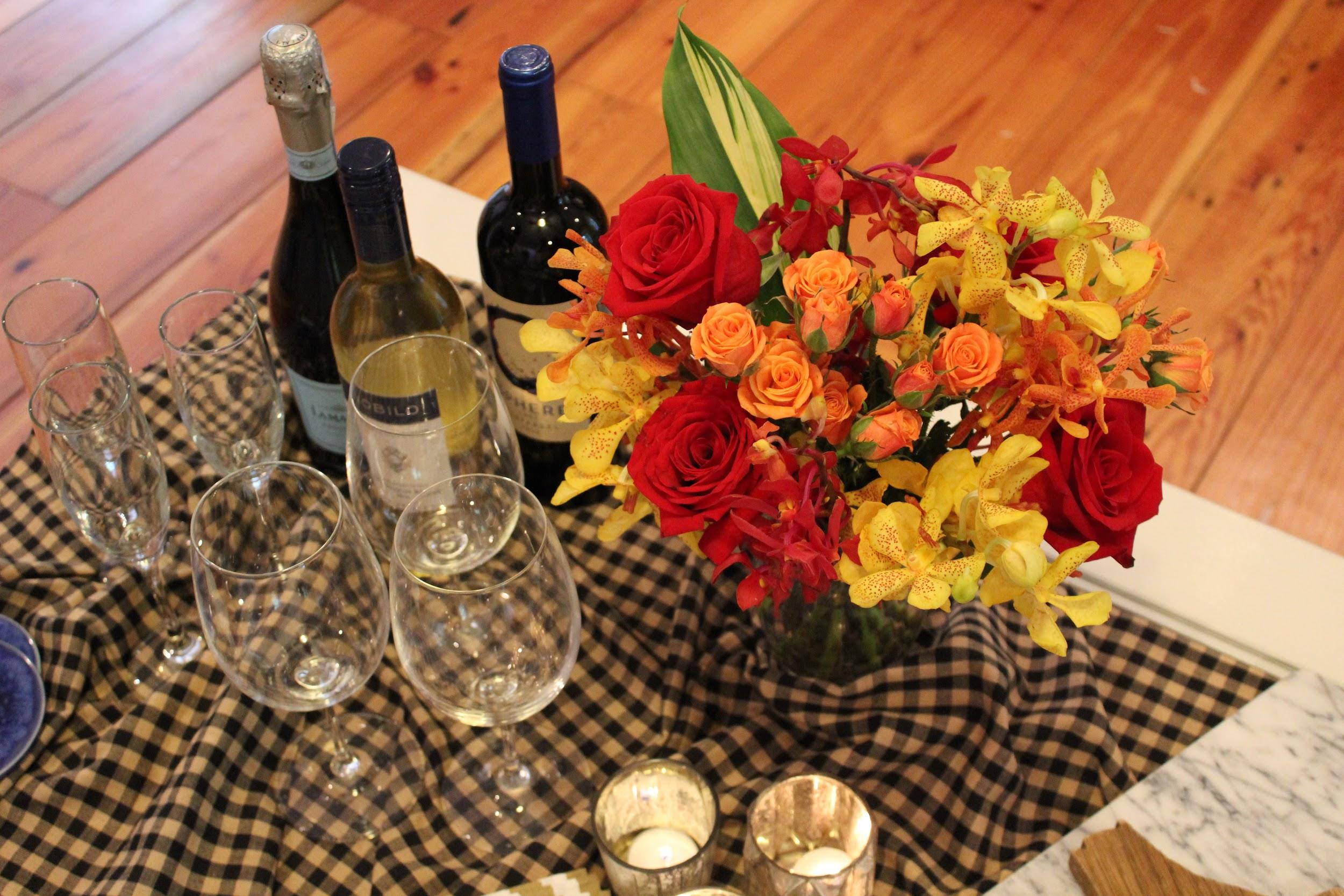 bouquet of flowers with wine and glasses