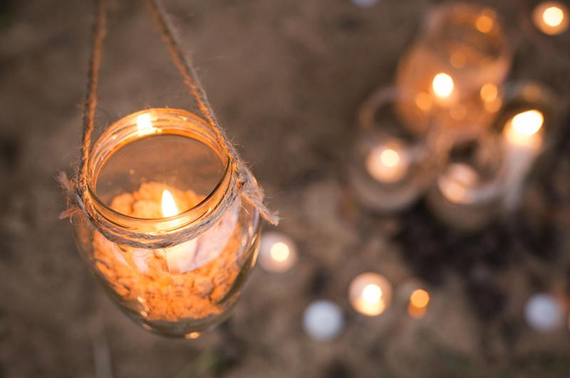 candles in hanging vases