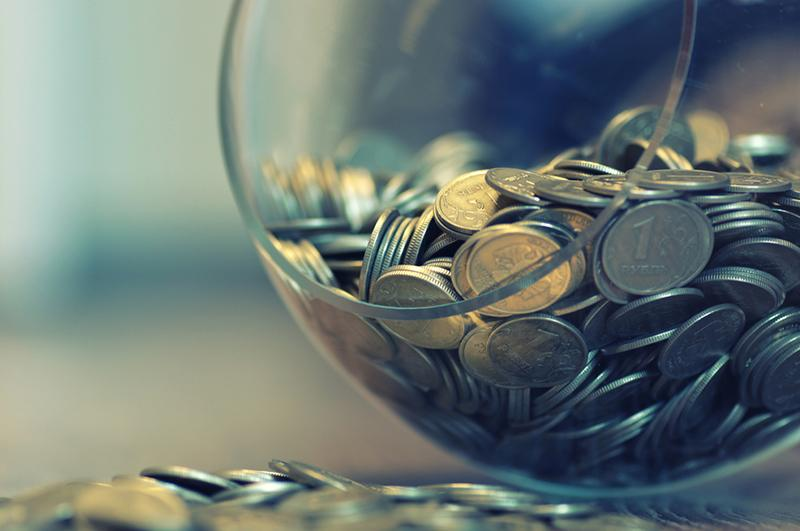 coins in a glass vase