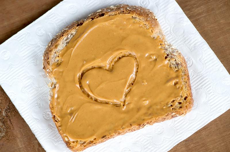 heart drawn in sesame seed butter on bread