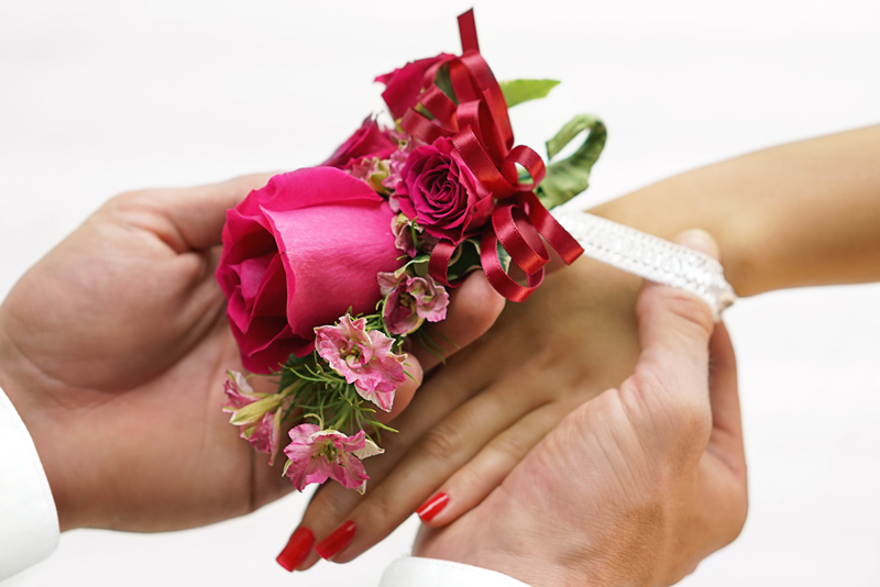 putting on a corsage