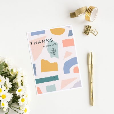 colorful thank you card with daisies and a fountain pen.