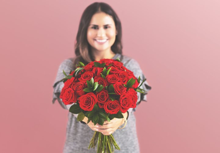woman with bouquet of roses.