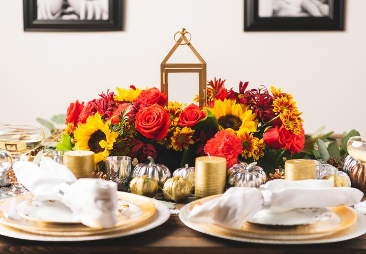 floral lantern centerpiece on thanksgiving table.