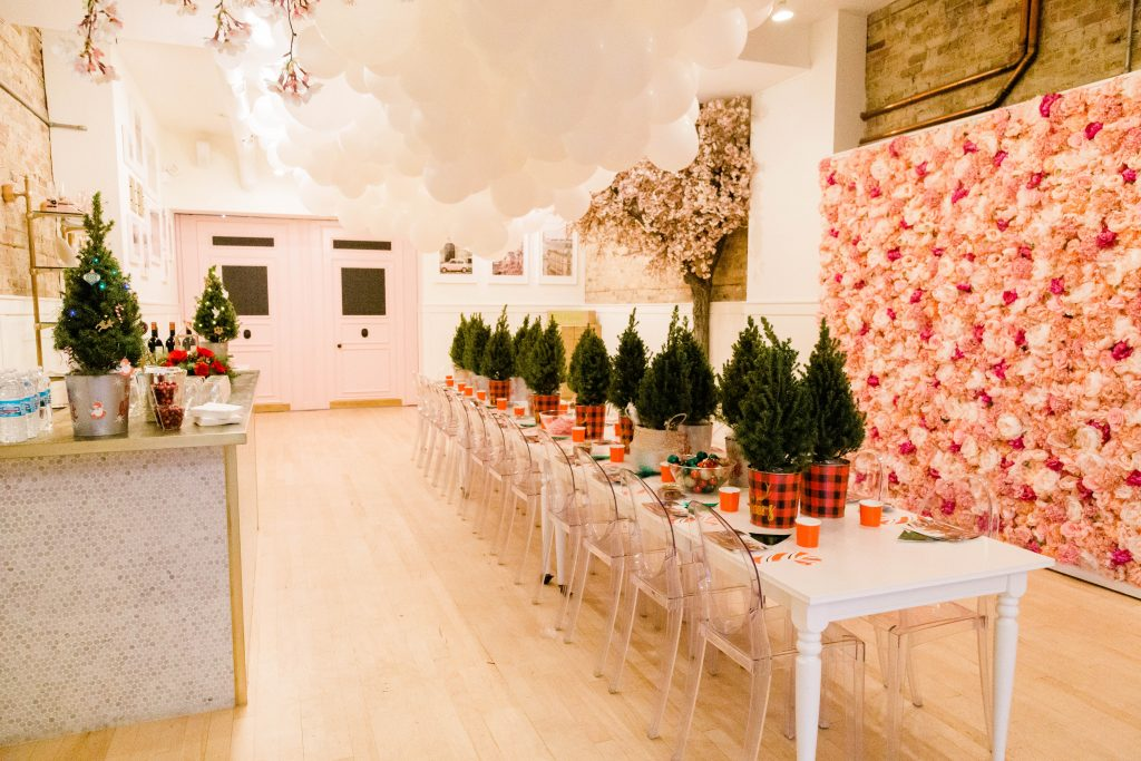 Table of Mini Christmas Trees for Decorating Party
