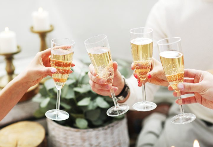 group of friends toasting champagne