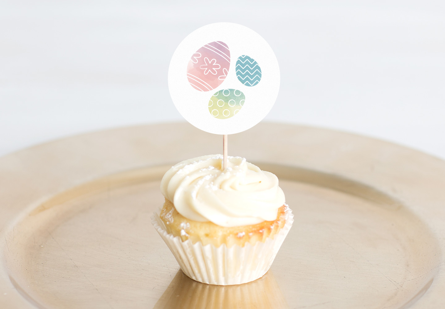easter cupcake topper with a cupcake on a gold plate