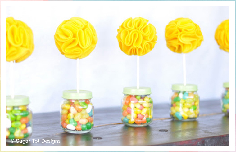 baby jar topiaries with yellow flowers