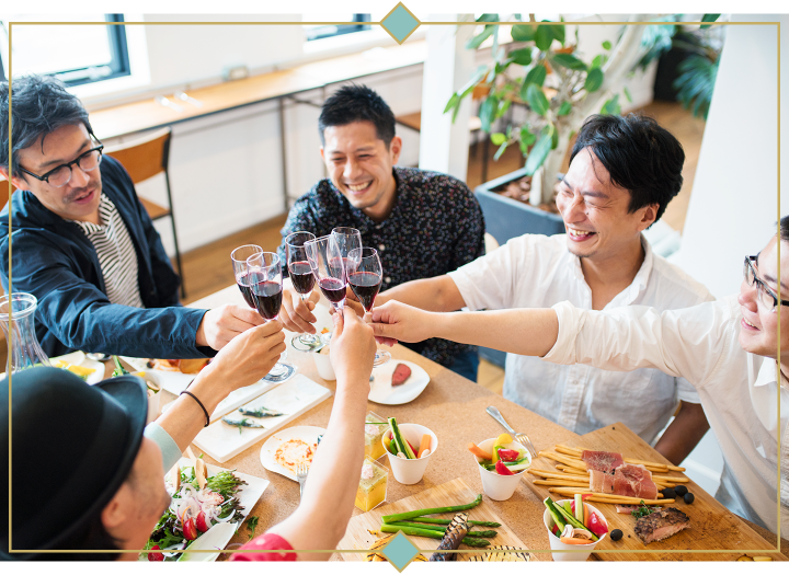 group of friends toasting wine glasses