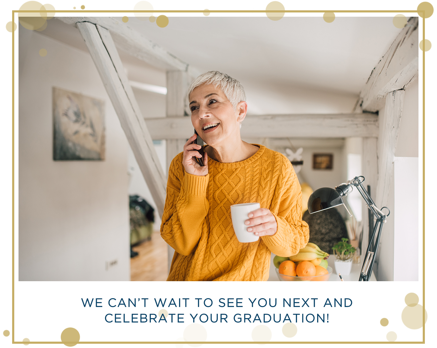 woman wearing orange sweater calling a recent grad on the phone