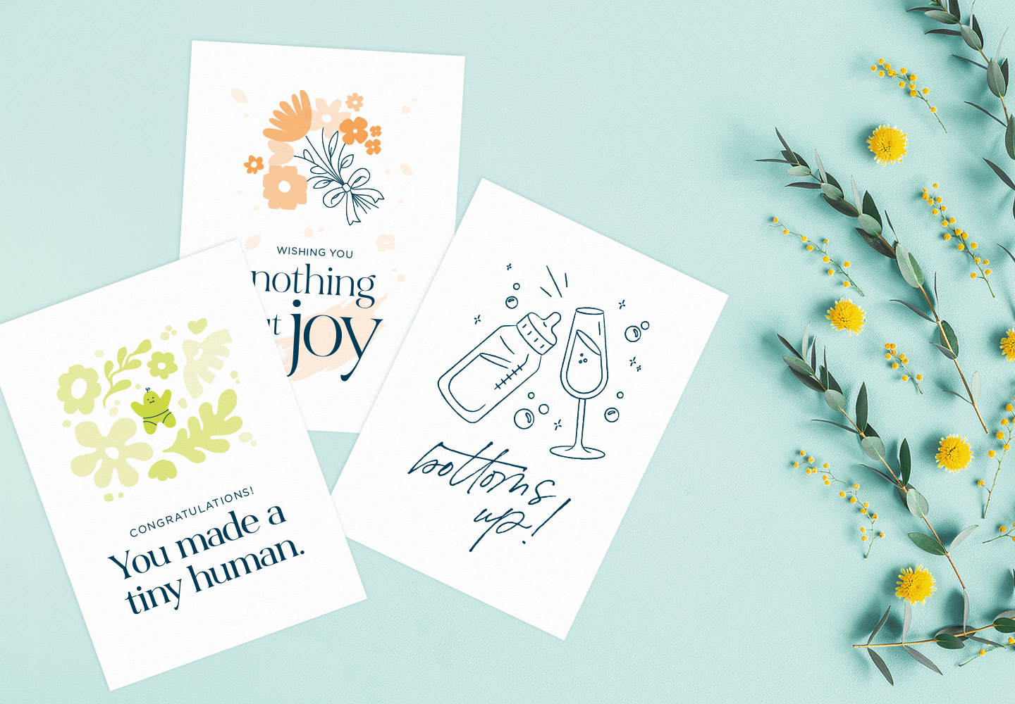 new baby cards on a blue background with flowers