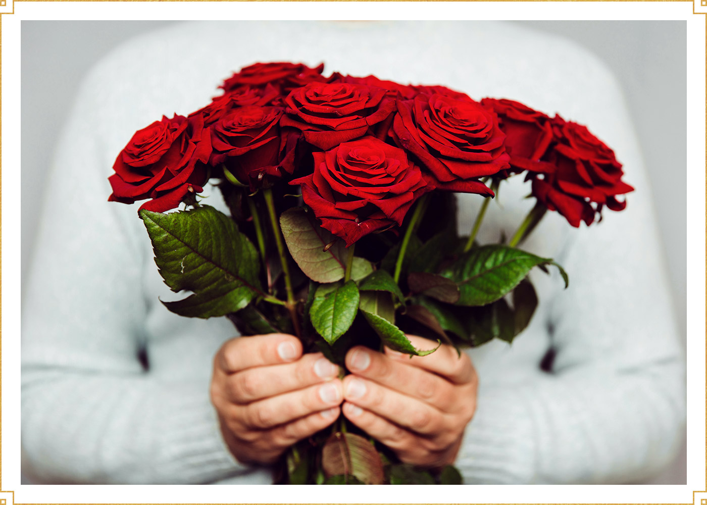photo of man holding red roses