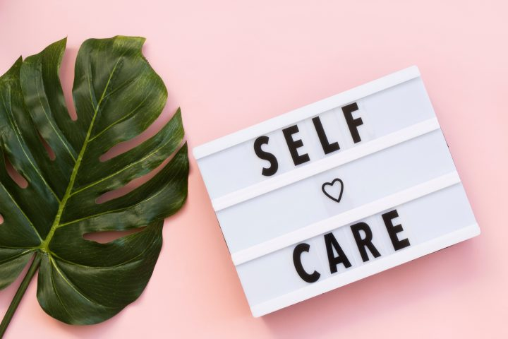Self Care Day Sign on Pink Background
