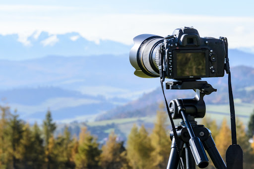 Camera set up to take pictures of mountains in the distance