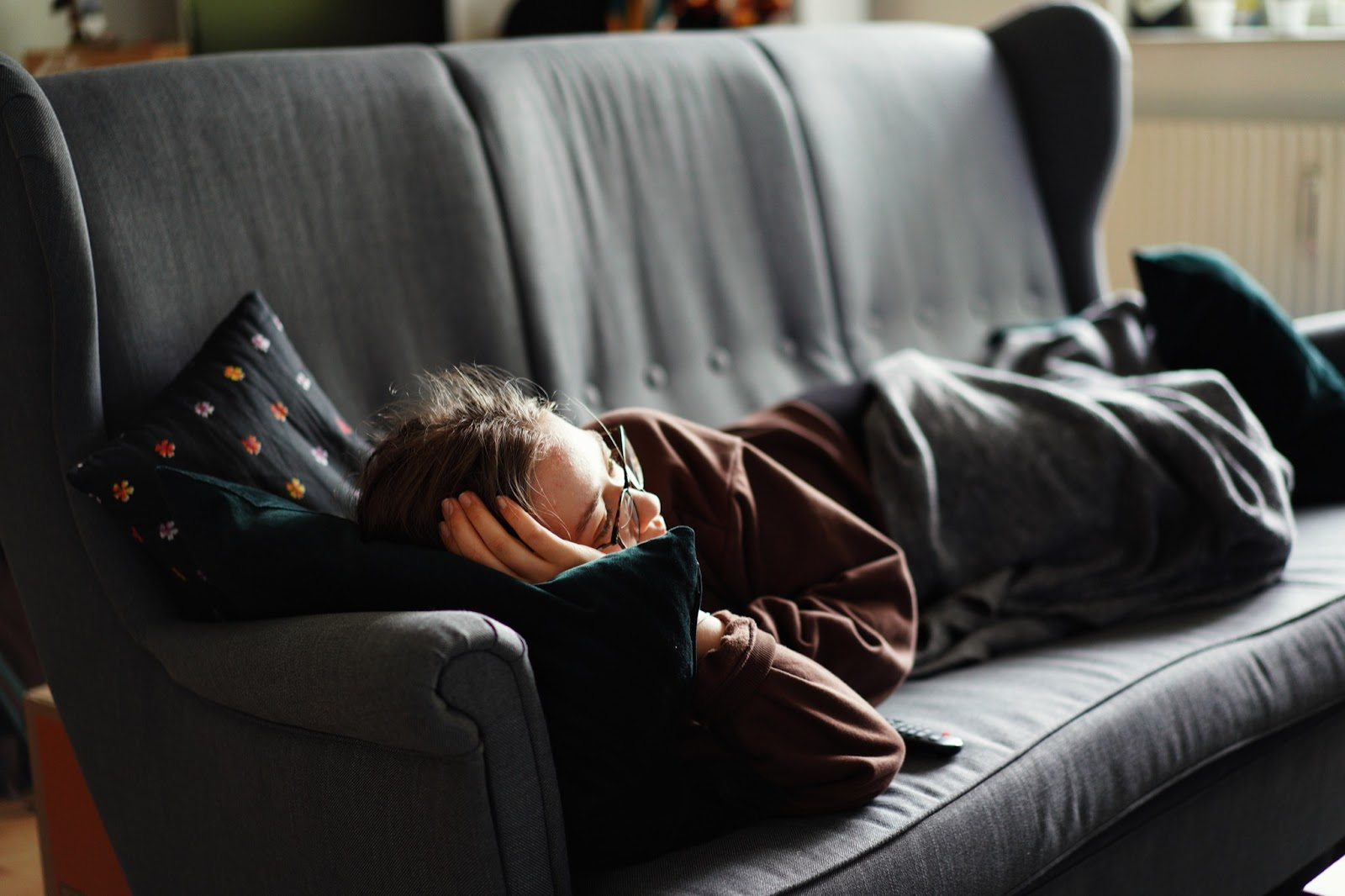 Woman laying comfortably on couch