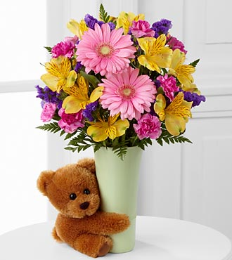 The FTD Festive Big Hug Flower Bouquet